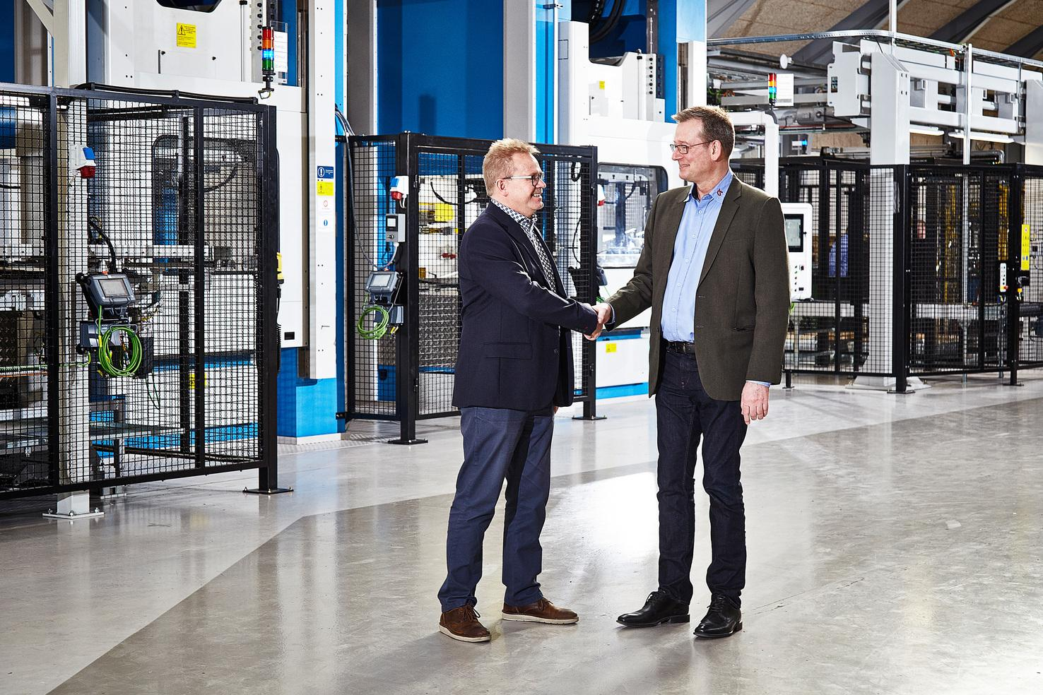 With the new line in operation, 90% of CK Deep Drawing's production is automated. Pictured here are Peter Karlsson from AP&T (left) and CK Deep Drawing's CEO Peter Møller (right).