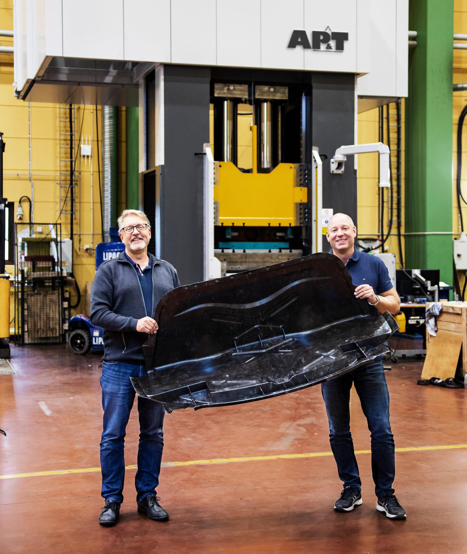 The use of lighter composite materials may be on the rise for the cars of the future. Kent Eriksson and Roger Nyman of AP&T display a combined hat rack and back wall made of an advanced carbon fiber composite.