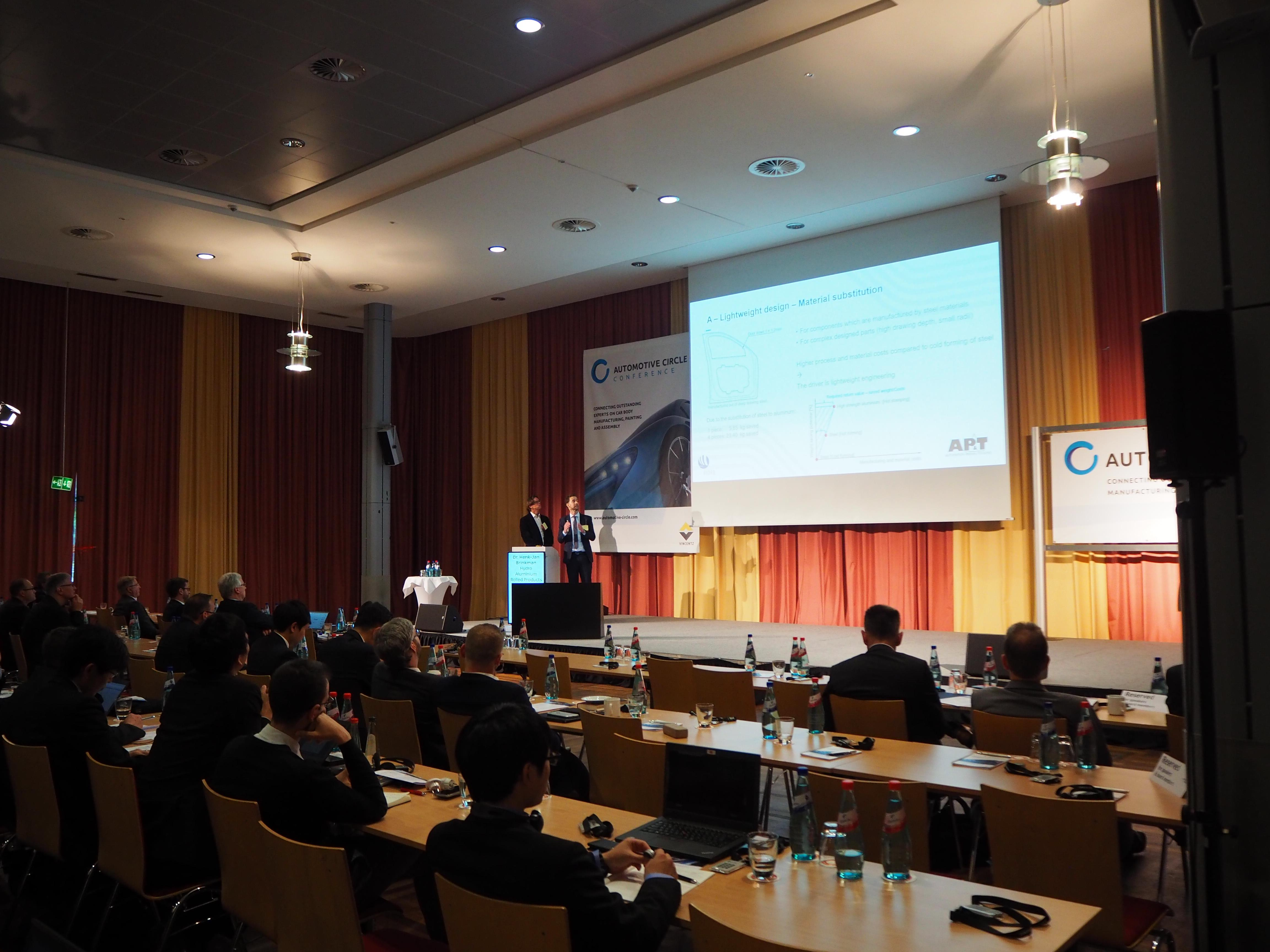 Dr. Michael Machhammer from AP&T and Dr. Henk-Jan Brinkman from Hydro Aluminium presented how hot forming of high-strength aluminum enables new opportunities for manufacturing lightweight and high-strength car body parts. (Photograph: Automotive Circle).